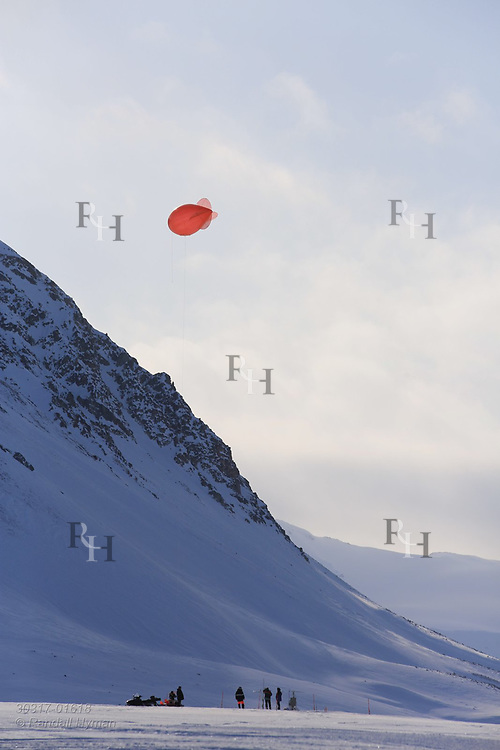 Scientists launch tethered weather blimp outside the international science village of Ny-Alesund on Spitsbergen island in Kongsfjorden; Svalbard, Norway.