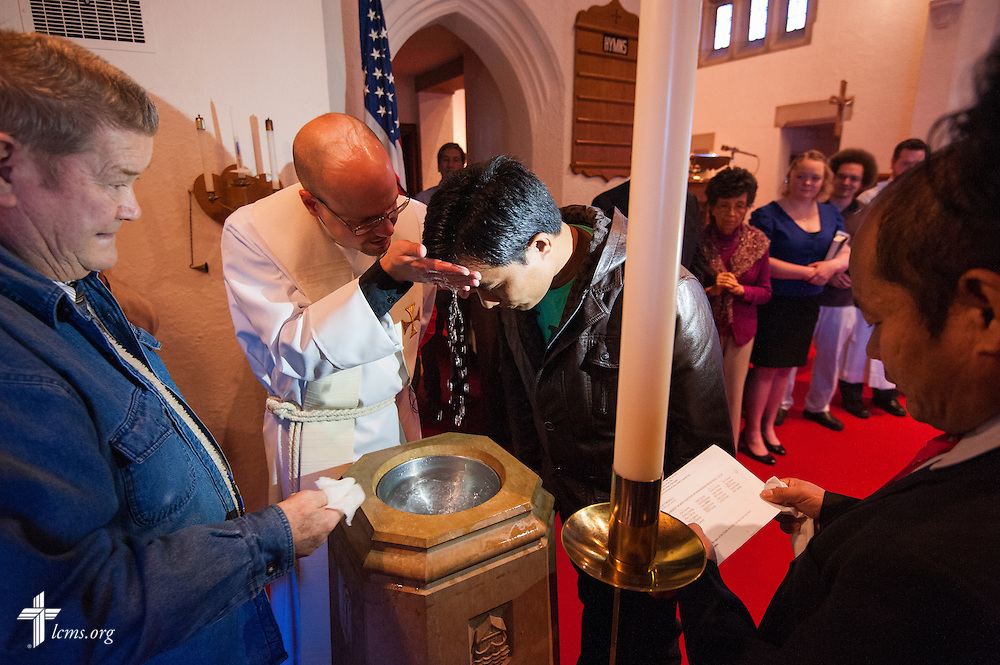 The Rev. Matthew Clark baptizes 21 Nepali immigrants, including Rana Tamang, on Sunday, Jan. 12, 2014, at Ascension Lutheran Church in St. Louis, Mo. LCMS Communications/Erik M. Lunsford