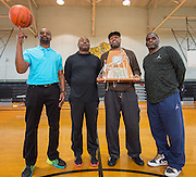 Members of the 1988 Houston High School state championship team L-R: Jodie Arthur, Jay Randle, Kethus Hanks and Cedrick Burks pose for a photograph at The Sam Houston Math, Science and Technology Center as the current team boy's basketball team prepares to leave for the UIL State Basketball Tournament, March 10, 2016.