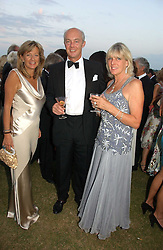 Left to right, PRINCESS CHANTAL OF HANOVER and The EARL & COUNTESS OF WESTMORLAND at the Cowdray Gold Cup Golden Jubilee Ball held at Cowdray Park Polo Club, on 21st July 2006.<br />