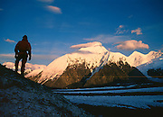Mt. Brooks, Alaska Range, AK, USA<br /> Climber looking to Mt Brooks from<br /> McGonnagal Pass, Mt Mckinley<br /> Denali National Park
