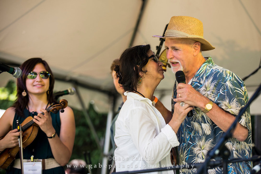Maggi Landau, Artistic Director for Roots Music at Caramoor, and John Platt, WFUV host of the Sunday Breakfast show and the festival Master of Ceremonies, makes introductions at  the Friends Field set at the American Roots Music Festival at Caramoor in Katonah New York on June 28, 2014. <br /> (photo by Gabe Palacio)