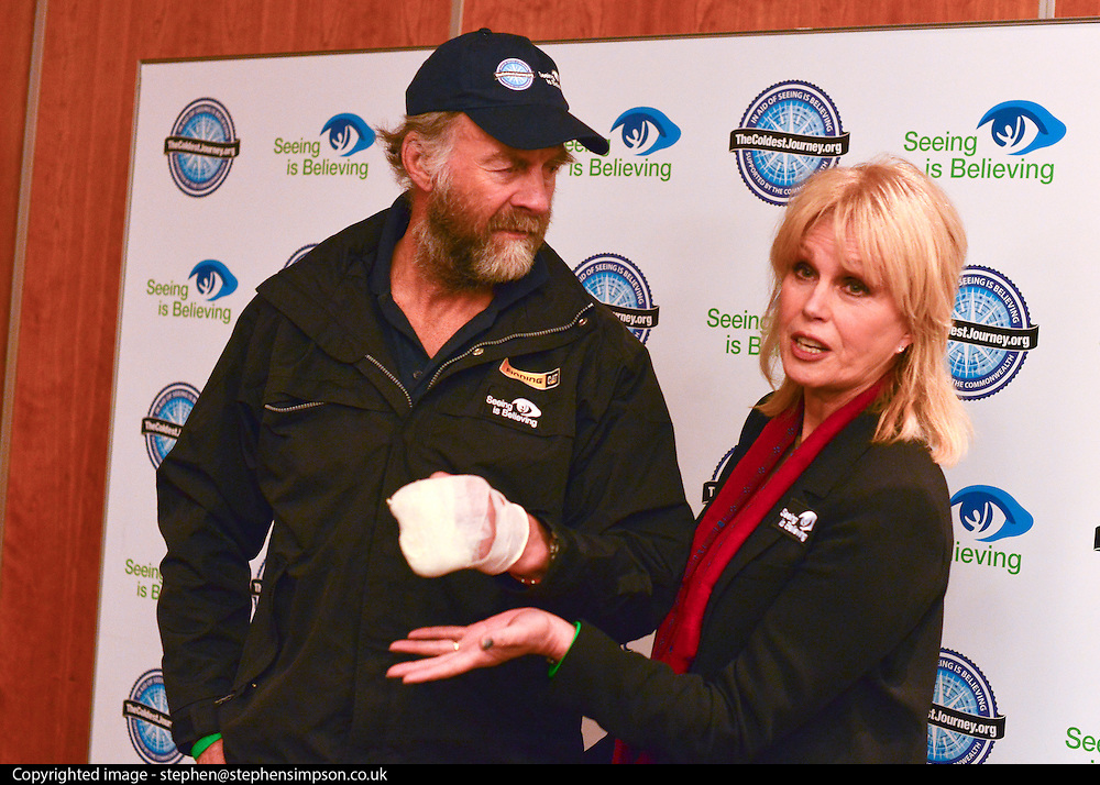 """© Licensed to London News Pictures. 04/03/2013. Heathrow, UK Sir Ranulph Fiennes, with his left hand bandaged, talks with Joanna Lumley - Expedition Trustee. Explorer Sir Ranulph Fiennes returns to the UK after pulling out of """"The Coldest Journey"""" Expedition to the Antarctic at winter due to frostbite. The Coldest Journey Press Conference today 4th March 2013 at Heathrow Airport. Photo credit : Stephen Simpson/LNP"""