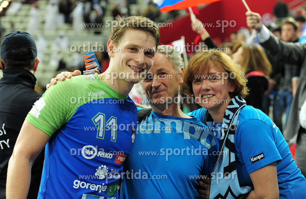 Jure Dolenec #11 of Slovenia with his parents after the handball match between National Teams of Slovenia and Qatar at Day 5 of 24th Men's Handball World Championship Qatar 2015 on January 19, 2015 in Al Bin Hamad Al Attiya Arena, Doha, Qatar. Photo by Slavko Kolar / Sportida
