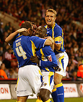Photo: Paul Greenwood.<br />Sheffield United v Cardiff City. Coca Cola Championship. 02/10/2007.<br />Cardifff's Gavin Rae, (L) and Stephen McPhail mob Jimmy Floyd Hasselbaink.