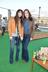 Left to right, ZARA MARTIN and CHARLOTTE DE CARLE at the launch of the Orangina Boulers Rooftop Petanque held on the top floor of the Stratford Multistorey Car Park, Great Eastern Way, London E15 on 26th August 2015.
