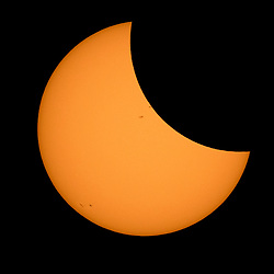 The Moon is seen passing in front of the Sun during a solar eclipse from Ross Lake, Northern Cascades National Park, Washington on Monday, Aug. 21, 2017. A total solar eclipse swept across a narrow portion of the contiguous United States from Lincoln Beach, Oregon to Charleston, South Carolina. A partial solar eclipse was visible across the entire North American continent along with parts of South America, Africa, and Europe.  Photo Credit: (NASA/Bill Ingalls)