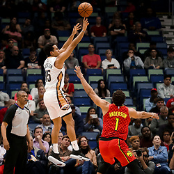 Mar 26, 2019; New Orleans, LA, USA; New Orleans Pelicans guard Frank Jackson (15) shoots over Atlanta Hawks guard Justin Anderson (1) during the second quarter at the Smoothie King Center. Mandatory Credit: Derick E. Hingle-USA TODAY Sports