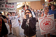 14 OCTOBER 2011 - PHOENIX, AZ:   Protesters in front of the Bank of America in Phoenix during the Occupy Phoenix march. About 300 people participated in the Occupy Phoenix march through downtown Phoenix Friday evening, Oct. 14. The march was the first event in the Occupy Phoenix protests which start with the occupation of Cesar Chavez Plaza, a large square in downtown Phoenix.  Photo PHOTO BY JACK KURTZ