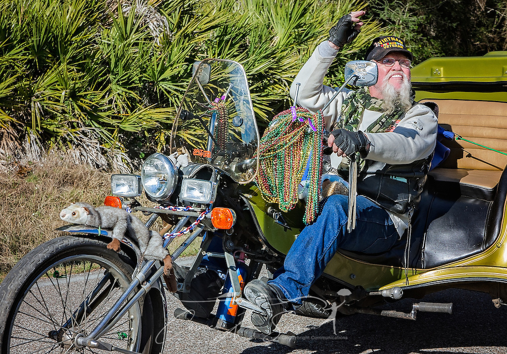 A biker waves to the crowd as he drives his Harley-Davidson in Dauphin Island's first People's Parade during Mardi Gras, Feb. 4, 2017, in Dauphin Island, Alabama. French settlers held the first Mardi Gras in 1703, making Mobile's celebration the oldest Mardi Gras in the United States. The first parade of the season is traditionally held on Dauphin Island and draws thousands. (Photo by Carmen K. Sisson/Cloudybright)