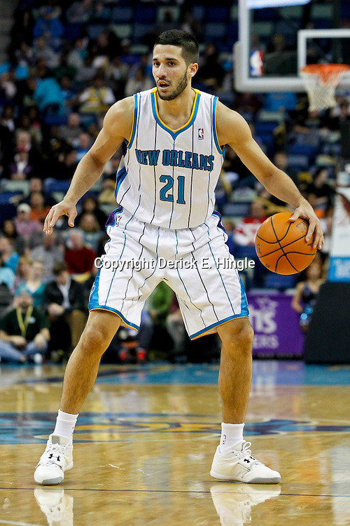 January 29, 2012; New Orleans, LA, USA; New Orleans Hornets point guard Greivis Vasquez (21) against the Atlanta Hawks during the first half of a game at the New Orleans Arena.   Mandatory Credit: Derick E. Hingle-US PRESSWIRE