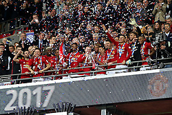 Wayne Rooney of Manchester United lifts the EFL trophy with his team mates - Mandatory by-line: Matt McNulty/JMP - 26/02/2017 - FOOTBALL - Wembley Stadium - London, England - Manchester United v Southampton - EFL Cup Final
