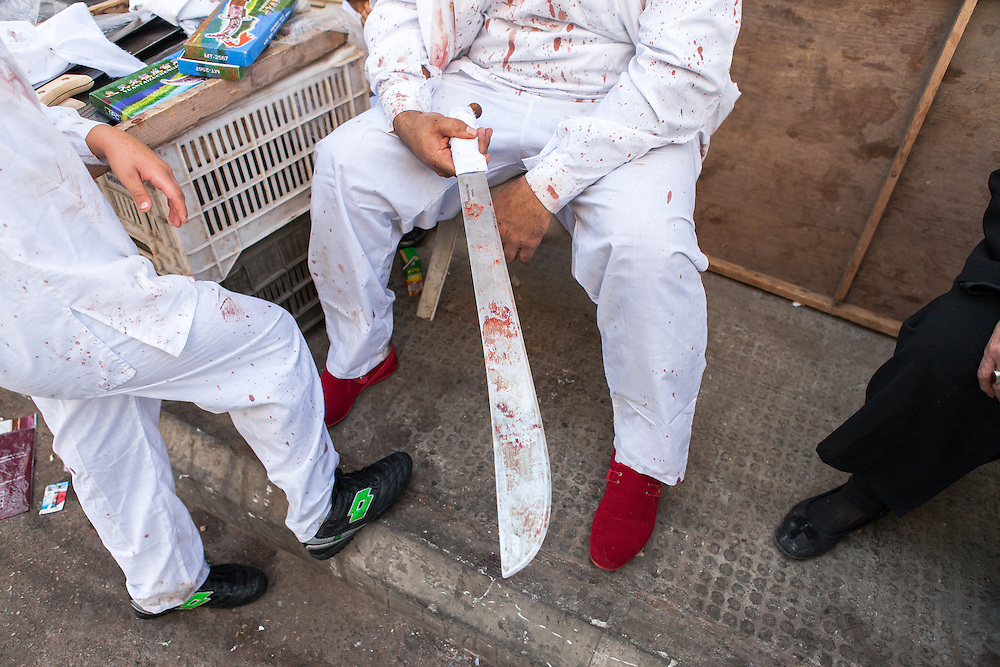 Shiite muslim man with a long, bloody, traditional sword, during the Day of Ashura, Nabatieh, Lebanon (November 14, 2013).