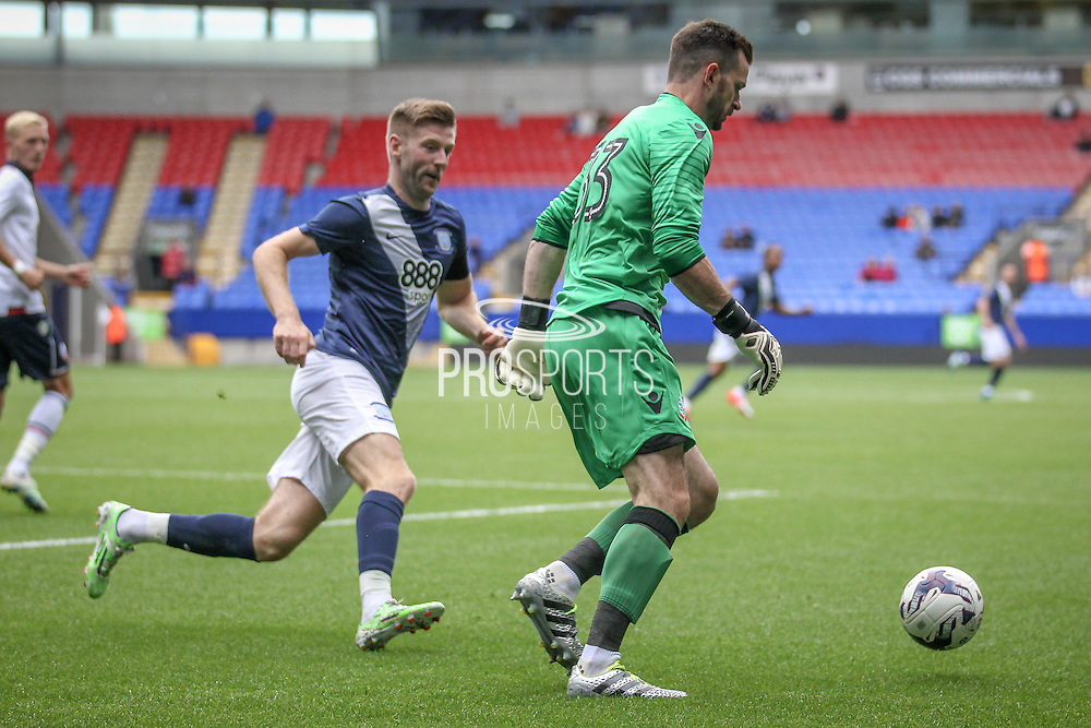Mark Howard (Bolton Wanderers) runs outside of his penalty box under pressure from Paul Gallagher (Preston North End) during the Pre-Season Friendly match between Bolton Wanderers and Preston North End at the Macron Stadium, Bolton, England on 30 July 2016. Photo by Mark P Doherty.
