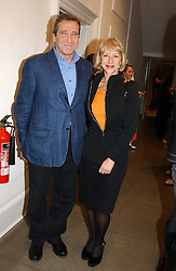 Actress HELEN MIRREN and her husband MR TAYLOR HACKFORD at 'A Night at Crumbland' an evening to celebrate the launch of the Stella McCartnry and Robert Crumb collaboration aand the publication of the R.Crumb handbook, held at Stella McCartney, 30 Bruton Street, London W1 on 17th March 2005.<br /><br />NON EXCLUSIVE - WORLD RIGHTS