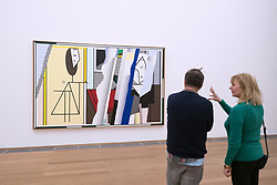 "Visitors looking at painting Reflections On ""The Artist's Studio"" by Roy Lichtenstein at Hamburger Bahnhof modern art museum in Berlin, Germany"