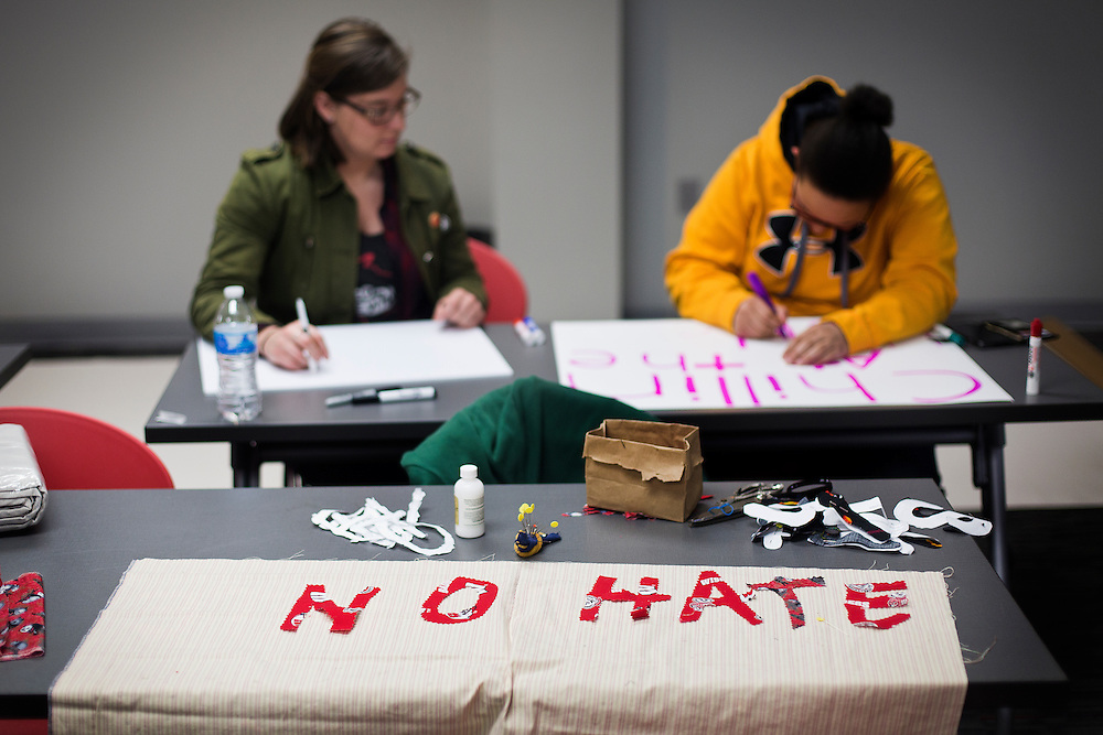MADISON, WI – MARCH 27: Protestors design protest signs at the UW South Madison Partnership space in advance of Presidential candidate Donald Trump's visit to Janesville, Wisconsin.