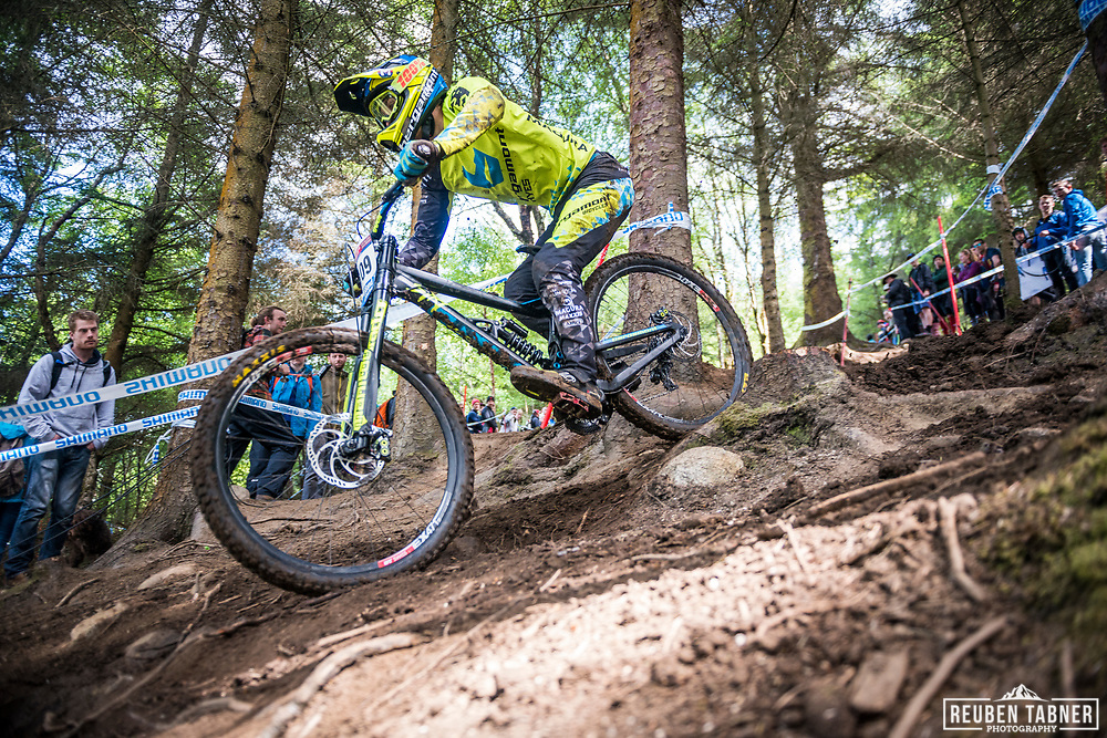 Reece Wilson finding his way through the trees during qualifying at the UCI Mountain Bike World Cup at Fort William.