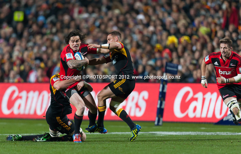 Crusaders' Zac Guildford tackled by Chiefs' Aaron Cruden during the Super Rugby Semi Final won by the Chiefs (20-17) against the Crusaders at Waikato Stadium, Hamilton, New Zealand, Friday 27 July 2012. Photo: Stephen Barker/Photosport.co.nz