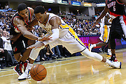 March 13, 2012; Indianapolis, IN, USA; Portland Trail Blazers small forward Nicolas Batum (88) and Indiana Pacers small forward Danny Granger (33) fight for a loose ball at Bankers Life Fieldhouse. Mandatory credit: Michael Hickey-US PRESSWIRE