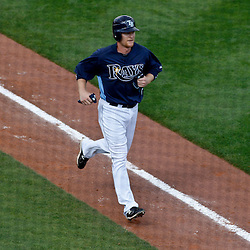 March 8, 2011; Port Charlotte, FL, USA; Tampa Bay Rays first baseman Dan Johnson (29) runs the bases after hitting a homerun during a spring training exhibition game against the Toronto Blue Jays at Charlotte Sports Park.   Mandatory Credit: Derick E. Hingle