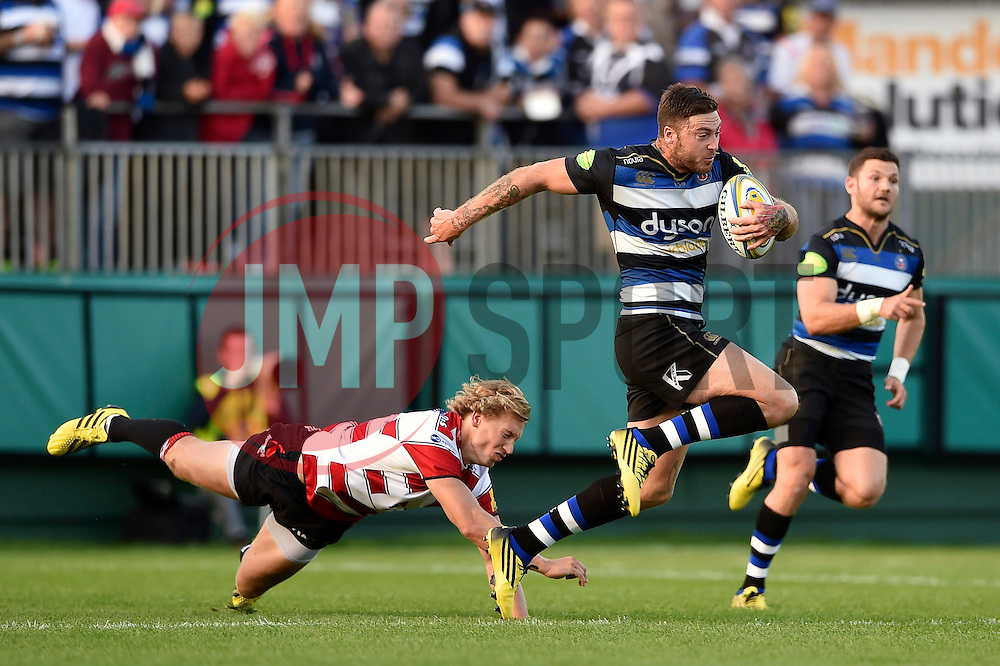 Matt Banahan of Bath Rugby gets past Billy Twelvetrees of Gloucester Rugby - Mandatory byline: Patrick Khachfe/JMP - 07966 386802 - 26/09/2015 - RUGBY UNION - The Recreation Ground - Bath, England - Bath Rugby v Gloucester Rugby - West Country Challenge Cup.