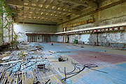 Abandoned gymnasium. The once-thriving city of Pripyat, which housed many of the nuclear facility's workers, became a ghost town overnight as frantic residents were evacuated from their homes. They were told the evacuation was a precautionary measure for a few days, maybe a few weeks. They would, of course, never return to their homes again.