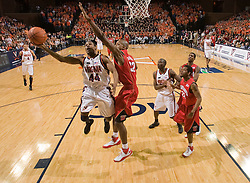 Virginia guard Sean Singletary (44) shoots a hook past Maryland forward Jerome Burney (32).  The Virginia Cavaliers defeated the Maryland Terrapins 91-76 at the University of Virginia's John Paul Jones Arena  in Charlottesville, VA on March 9, 2008.