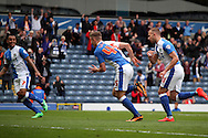 Blackburn Rovers&rsquo; Tom Cairney reels away to celebrate after after scoring his teams 1st goal. Skybet football league championship match, Blackburn Rovers v Wigan Athletic at Ewood Park in Blackburn, England on Saturday 3rd May 2014.<br /> pic by Chris Stading, Andrew Orchard sports photography.