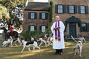 A minister performs the annual Blessing of the Hounds marking the start of the Fox Hunting season at Middleton Place Plantation November 27, 2016 in Charleston, SC. Fox hunting in Charleston is a drag hunt using a scented cloth to simulate a fox and no animals are injured.