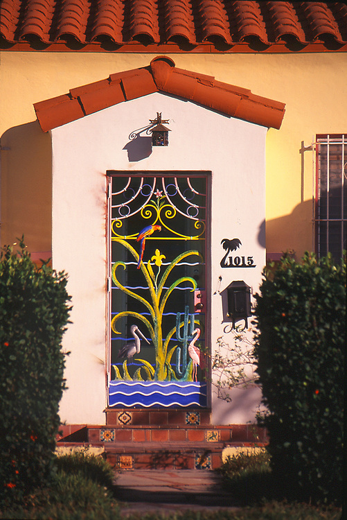 A vintage, Tropical Deco screen door on a single family home in Miami Beach's Flamingo Park neighborhood