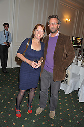 CATHY DEAN Director of Save The Rhino and DAVID STIRLING at a dinner in aid of the charity Save The Rhino held at ZSL London Zoo, Regents Park, London on 16th October 2012.