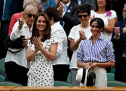 The Duchess of Cambridge and the Duchess of Sussex in the royal box on centre court applaud after watching Novak Djokovic beat Rafael Nadal on day twelve of the Wimbledon Championships at the All England Lawn Tennis and Croquet Club, Wimbledon.