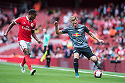 Benfica forward Andre Carrillo (15), RB Leipzig Marcel Halstenberg (23) during the Emirates Cup 2017 match between Leipzig and Benfica at the Emirates Stadium, London, England on 30 July 2017. Photo by Sebastian Frej.
