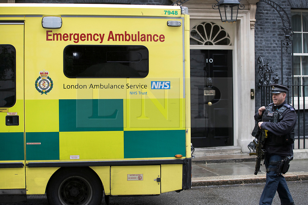 © Licensed to London News Pictures. 15/05/2017. London, UK. An ambulance waits at the door of 10 Downing Street after a worker was injured inside. A COBRA meeting is being held later as members of British government are meeting to discuss the recent cyber attack on over 150 countries, which crippled parts of the NHS.  Photo credit: Peter Macdiarmid/LNP