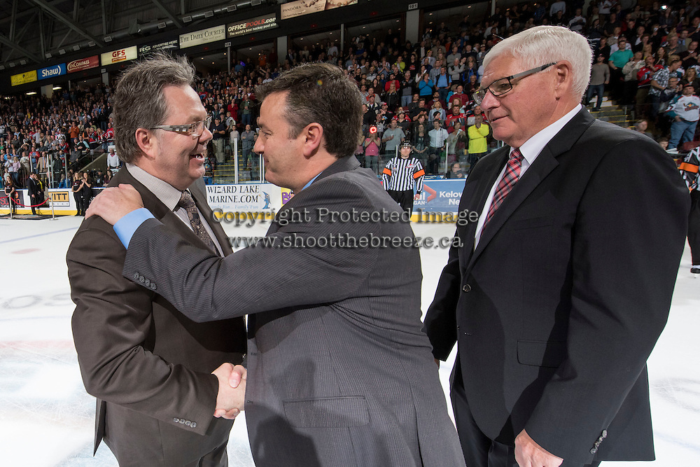 KELOWNA, CANADA - MAY 13: Brandon Wheat Kings head coach Kelly McCrimmon congratulates Kelowna Rockets head coach Dan Lambert and GM Bruce Hamilton on the WHL championship win on May 13, 2015 during game 4 of the WHL final series at Prospera Place in Kelowna, British Columbia, Canada.  (Photo by Marissa Baecker/Shoot the Breeze)  *** Local Caption *** Kelly McCrimmon; Dan Lambert; Bruce Hamilton;