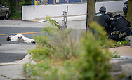 Michael Brizzi, wearing what he claimed was a bomb, lies in the street outside the Fox45 television station in Baltimore, Maryland, U.S. April 28, 2016. Police snipers shot and wounded Brizzi when he refused to obey their lawful orders.