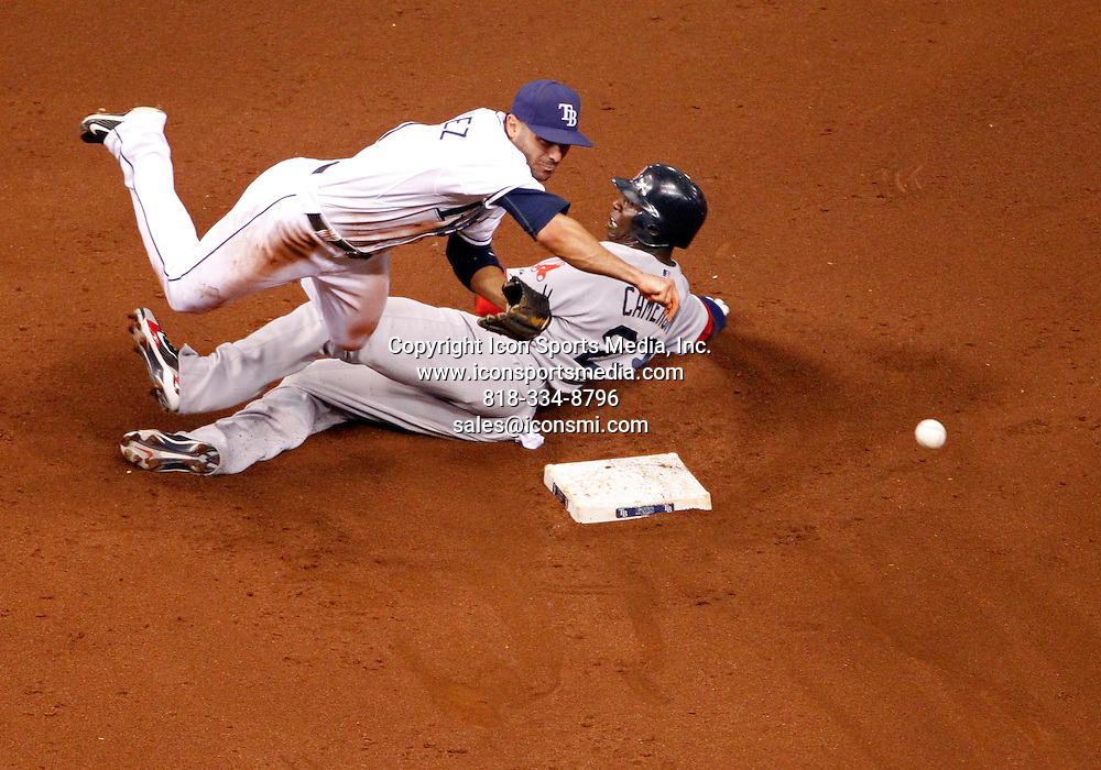July 07 2010:  Sean Rodriguez of the Tampa Bay Rays gets a throw over the slide of Mike Cameron of the Boston Red Sox at Tropicana Field in St. Petersburg, Fla.