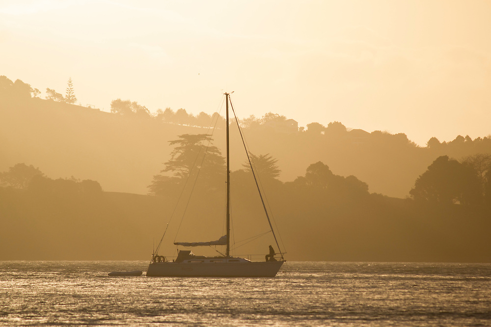 parua bay yacht at sunset