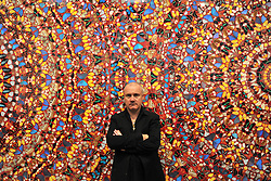 © Licensed to London News Pictures. 02/04/2012. London, UK . Damien Hirst stands in front ofI Am Become Death, Shatterer of Worlds 2006... The Tate Modern presents the first substantial retrospective of British artist Damien Hirst. The exhibition tuns 4th April - 9th September at Tate Modern London. Photographers Stephen Simpson/LNP