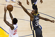 Golden State Warriors forward Kevin Durant (35) attempts to block a jump shot by LA Clippers guard Lou Williams (23) at Oracle Arena in Oakland, California, on February 22, 2018. (Stan Olszewski/Special to S.F. Examiner)
