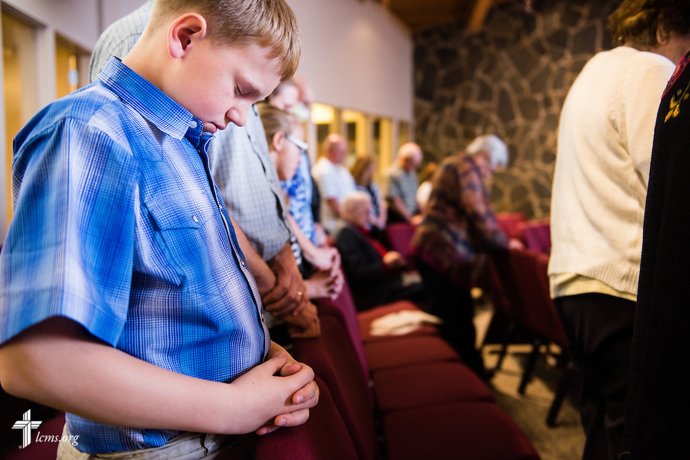 A young man prays during worship on Sunday, April 12, 2015, at Mount Calvary Lutheran Church in Holdrege, Neb. LCMS Communications/Erik M. Lunsford