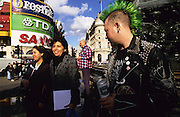 CITY GUIDE, LONDON.  Drinks,Punks, tourists, Picadilly Circus, London, England, Great Britain, Europe. Capital city. People, transport, shopping, lifestyle. Consumerism. Going out. Clubs, daytime, nightime. Tourism, visiting, attractions, tours, museums, food, eating,pubs, bars, drinking.