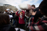 Photographer: Rick Findler<br /> <br /> 04.04.15 A massive pillow fight breaks out in Trafalgar Square, London this afternoon for International Pillow Fight Day. Thousands of people gathered in the capitals square for the annual event, which takes place in cities across the world.