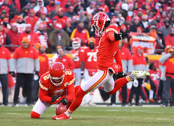 Jan 19, 2020; Kansas City, Missouri, USA; Kansas City Chiefs kicker Harrison Butker (7) kicks the point after touchdown with punter Dustin Colquitt (2) holding during the AFC Championship Game against the Tennessee Titans at Arrowhead Stadium. Mandatory Credit: Denny Medley-USA TODAY Sports