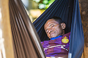 Man, asleep, western dress, hammock, Akha; Chiang Mai; Hill Tribe Village; Thailand