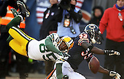 Green Bay Packer Greg Jennings leaps for an over thrown pass while being guarded by a Chicago Bear defender during the NFC Championship game in Chicago.