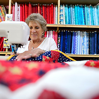 070114       Cayla Nimmo<br /> <br /> Marjorie Polich works on the finishing touches of the &quot;Quilts of Valor&quot; at Gallup Service Mart Tuesday afternoon.