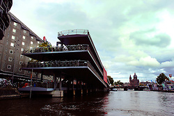 A view of a bicycle parking ramp from one of the many channels in Amsterdam.