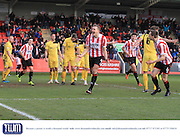 Danny Wright celebrates his first goal  during the Vanarama National League match between Cheltenham Town and Bromley at Whaddon Road, Cheltenham, England on 30 January 2016. Photo by Antony Thompson.